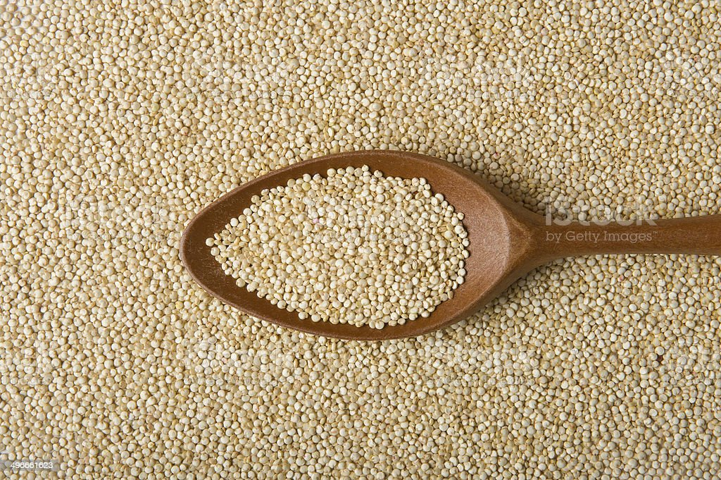 Quinoa Real on a wooden spoon royalty-free stock photo