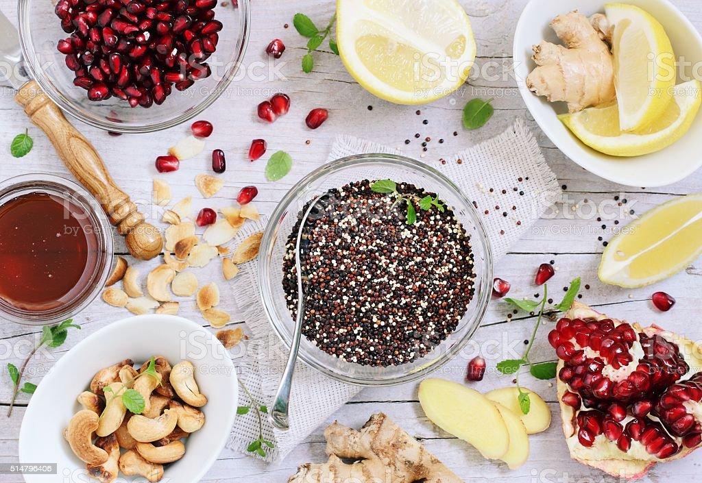 Quinoa salad and honey-lemon dressing ingredients stock photo