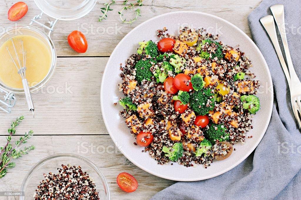 Quinoa salad with broccoli,sweet potatoes and tomatoes stock photo