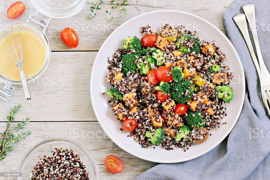 Quinoa salad with broccoli,sweet potatoes and tomatoes stock photo