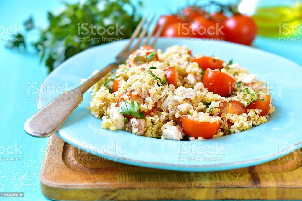 Quinoa salad with cherry tomatoes and chicken. stock photo