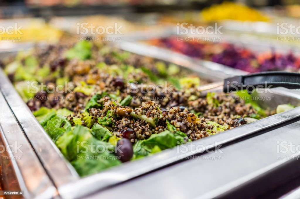 Quinoa salad with lettuce in bar with spoon stock photo