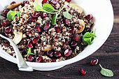 Quinoa salad with pomegranate and nuts.Superfoods concept
