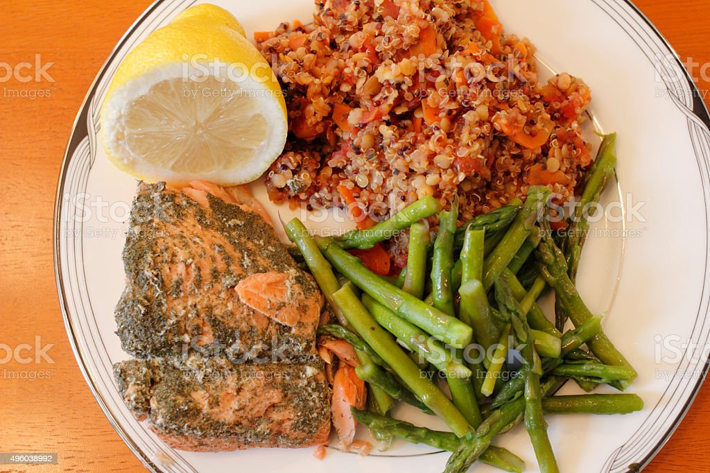Quinoa with Lentils, Asparagus and Salmon stock photo