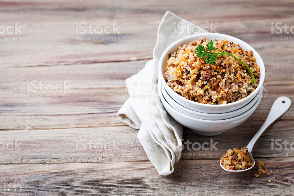 Quinoa with mushrooms and vegetables stock photo