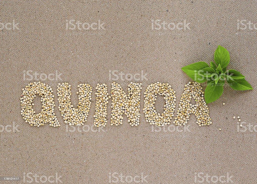 Quinoa word with basil stock photo