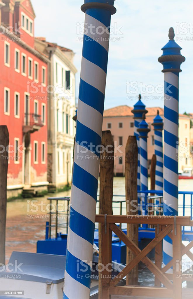 Quintessential Venice with Blue and White Mooring Poles at Dock stock photo