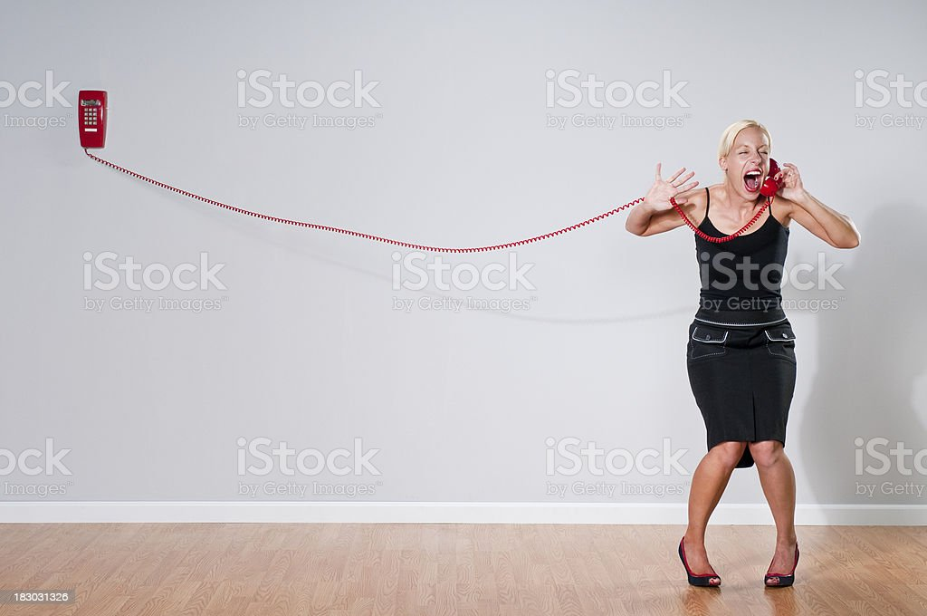 Quirky Blonde With Red Telephone royalty-free stock photo