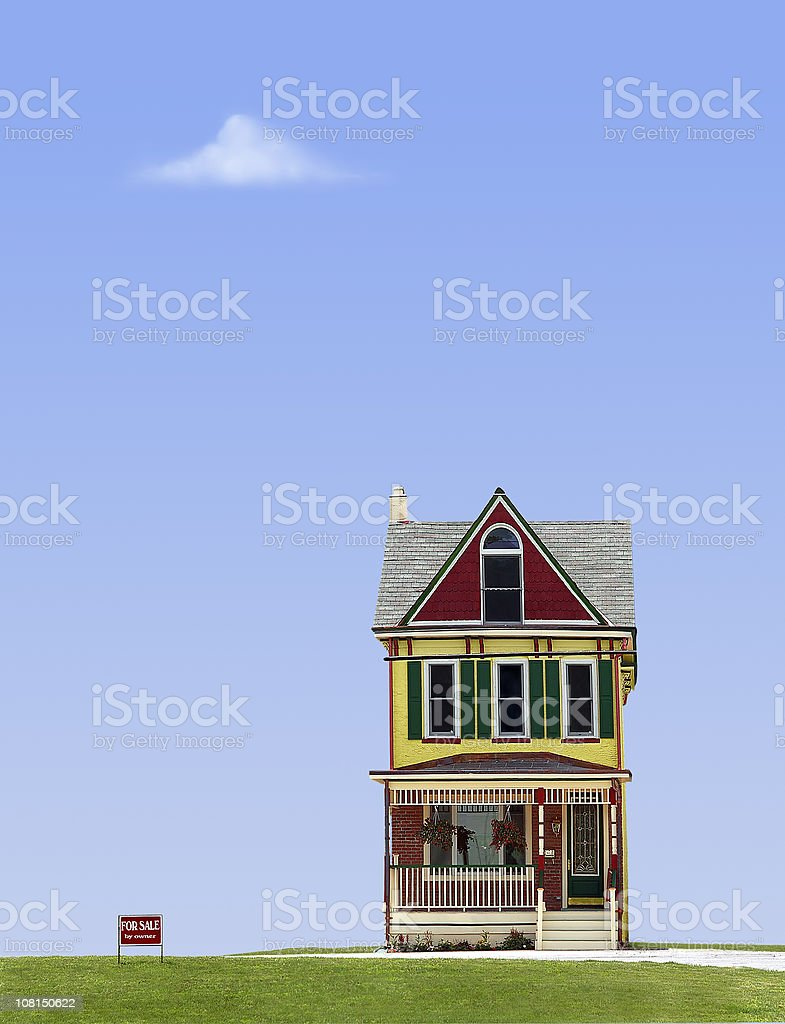 Quirky House with For Sale Against Blue Sky stock photo