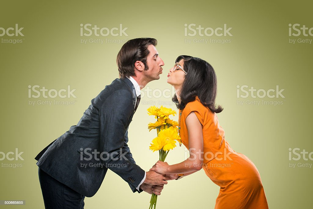 Quirky Stylish Couple Kissing stock photo
