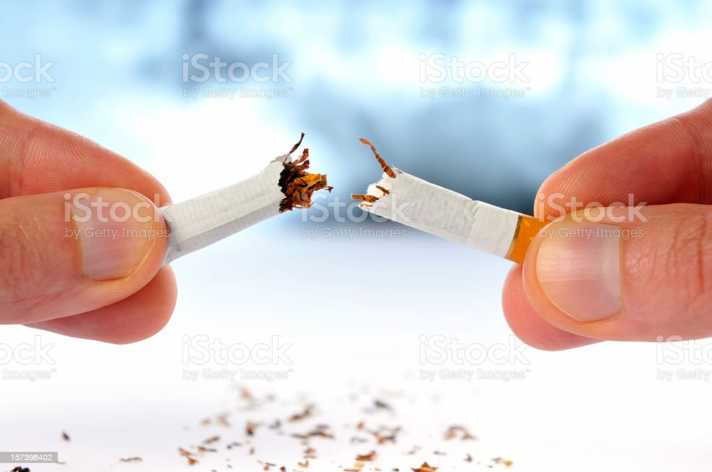 Quit smoking, cigarette broken in half, isolated white, x-ray background stock photo
