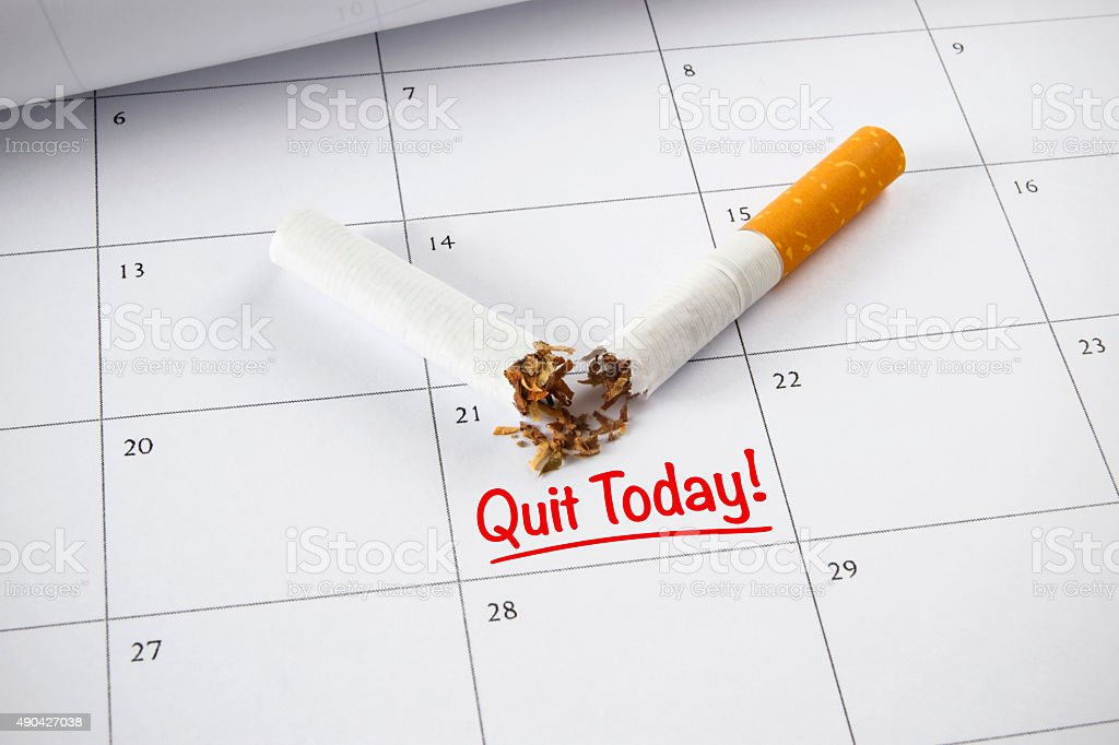 Quit Smoking Concept with Monthly Calendar stock photo