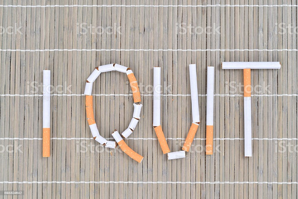 I quit smoking message made with cigarettes stock photo