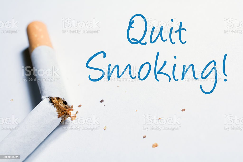 Quit Smoking Reminder With Broken Cigarette In Whitebox stock photo