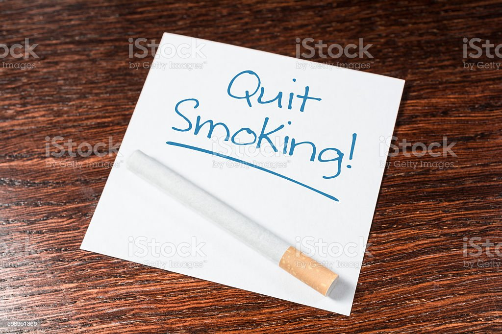 Quit Smoking Reminder With Cigarette On Wooden Shelf stock photo