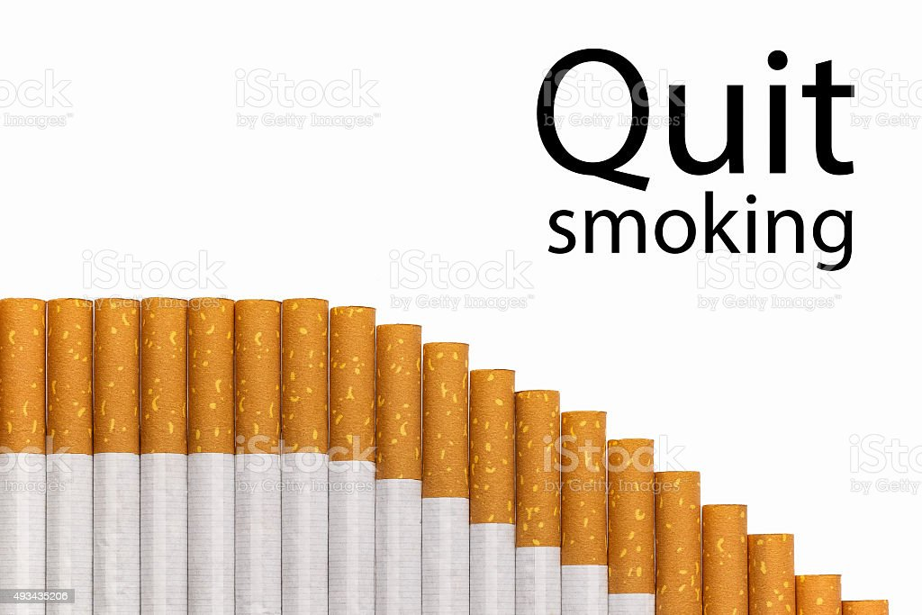 Quit smoking text graph of cigarettes stock photo