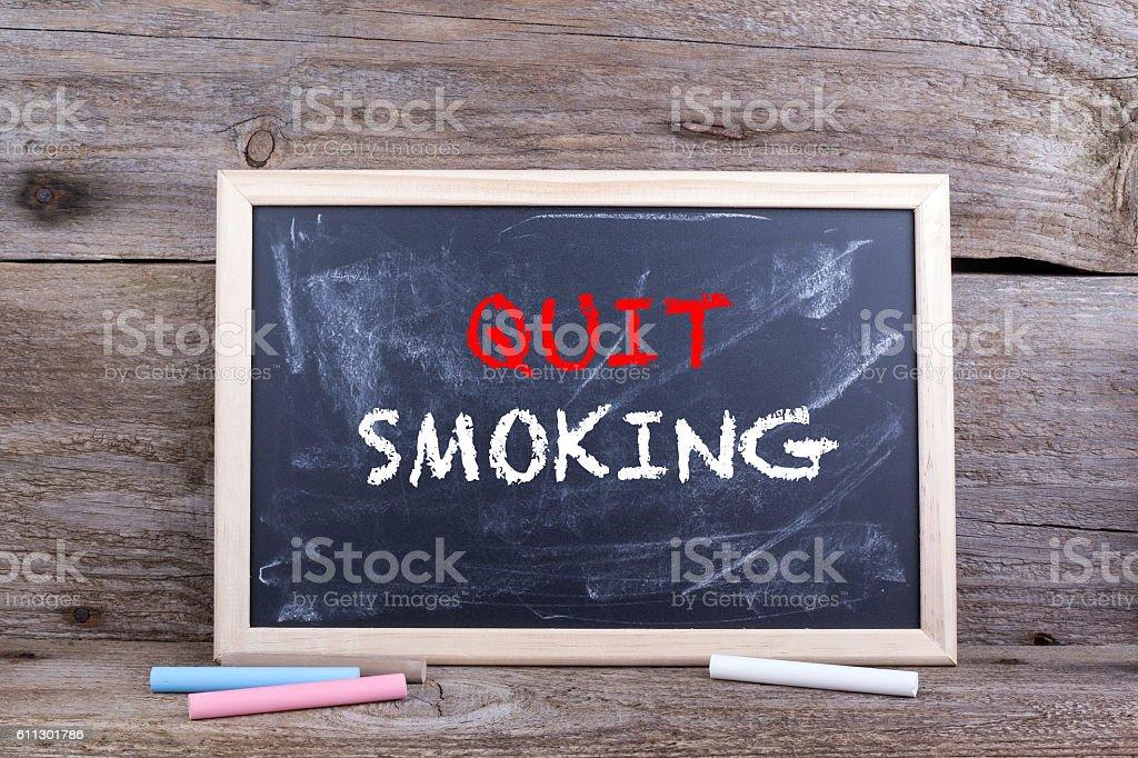 Quit Smoking. Text on blackboard stock photo