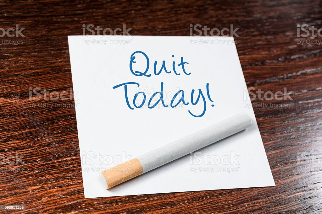 Quit Smoking Today Reminder With Cigarette On Wooden Shelf stock photo
