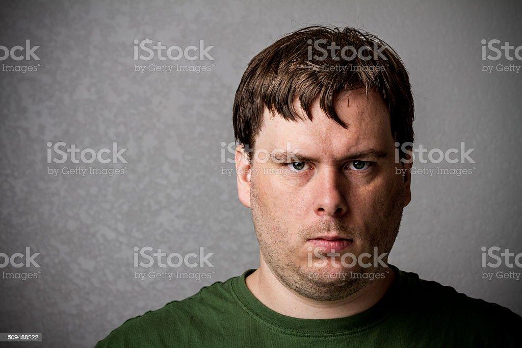 Quite unhappy man stock photo