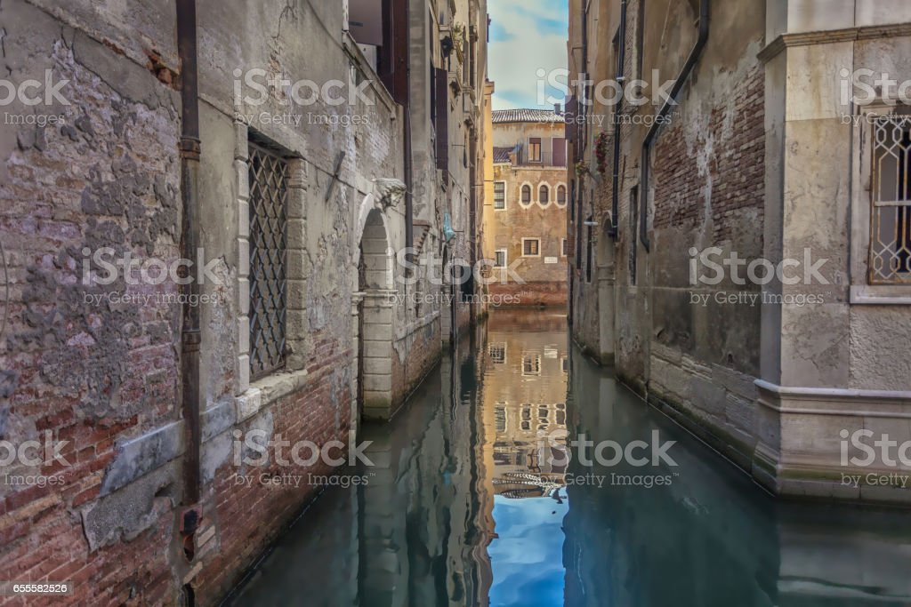 Quite Venetian back water canal. stock photo
