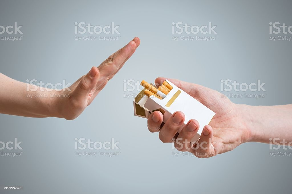 Quitting smoking concept. Hand is refusing cigarette offer. stock photo