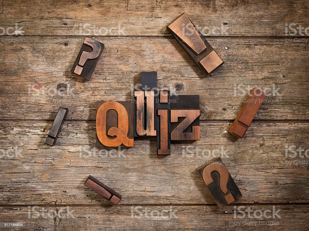 quiz written with letterpress type stock photo