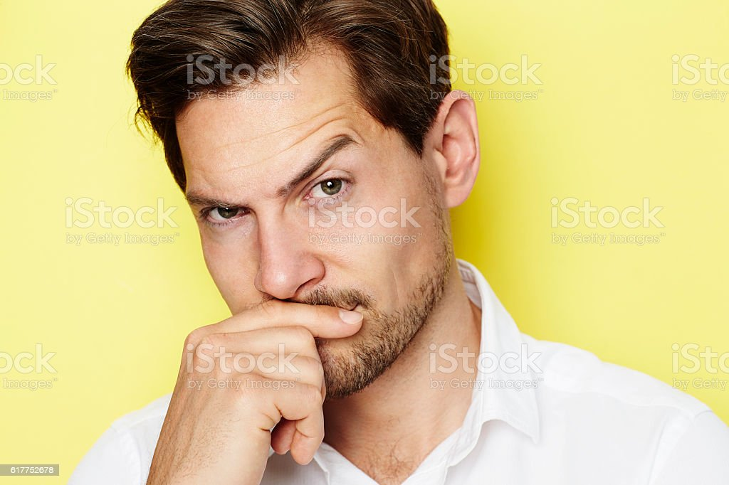 Quizzical guy stock photo