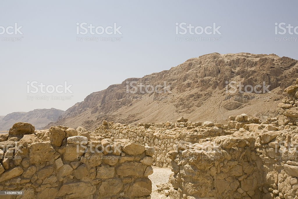 Qumran ruins with mountains in background stock photo