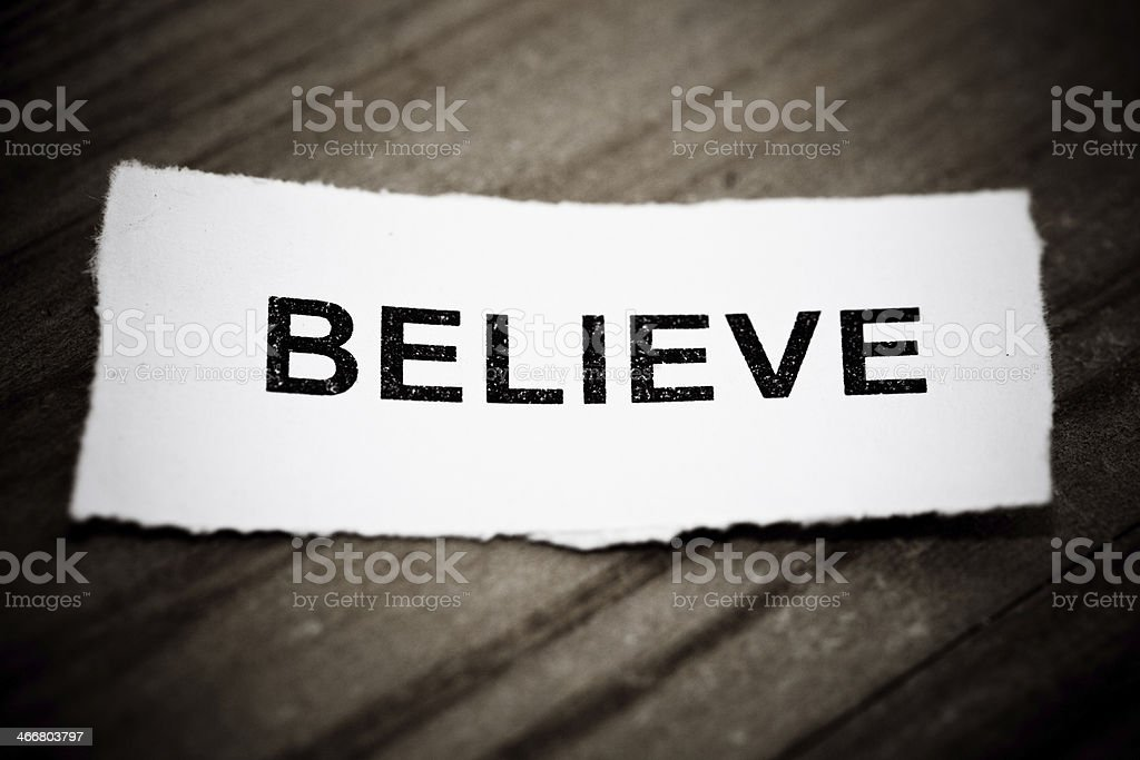 """""""Believe"""" text on wood background royalty-free stock photo"""