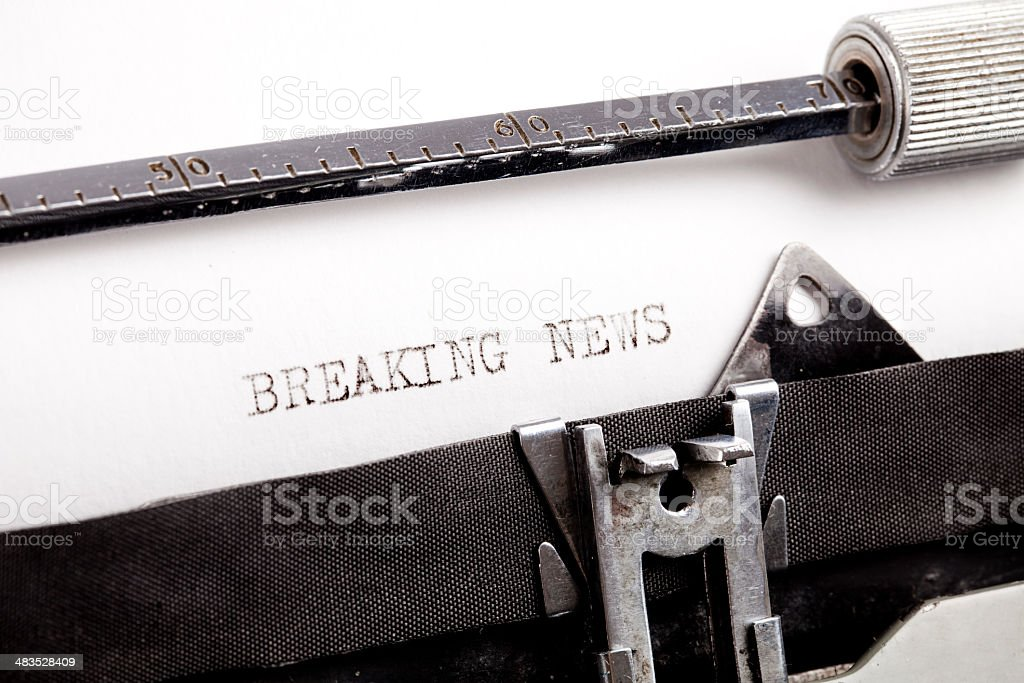 """Breaking News"" typed using an old typewriter royalty-free stock photo"