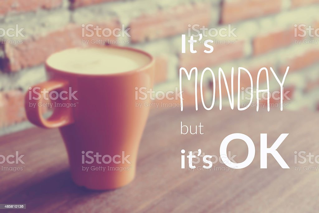 Quote on blurred coffee cup background with vintage filter stock photo