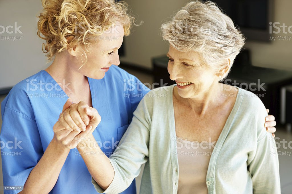 """Let's go get some fresh air!"" - Senior Rehabilitation stock photo"