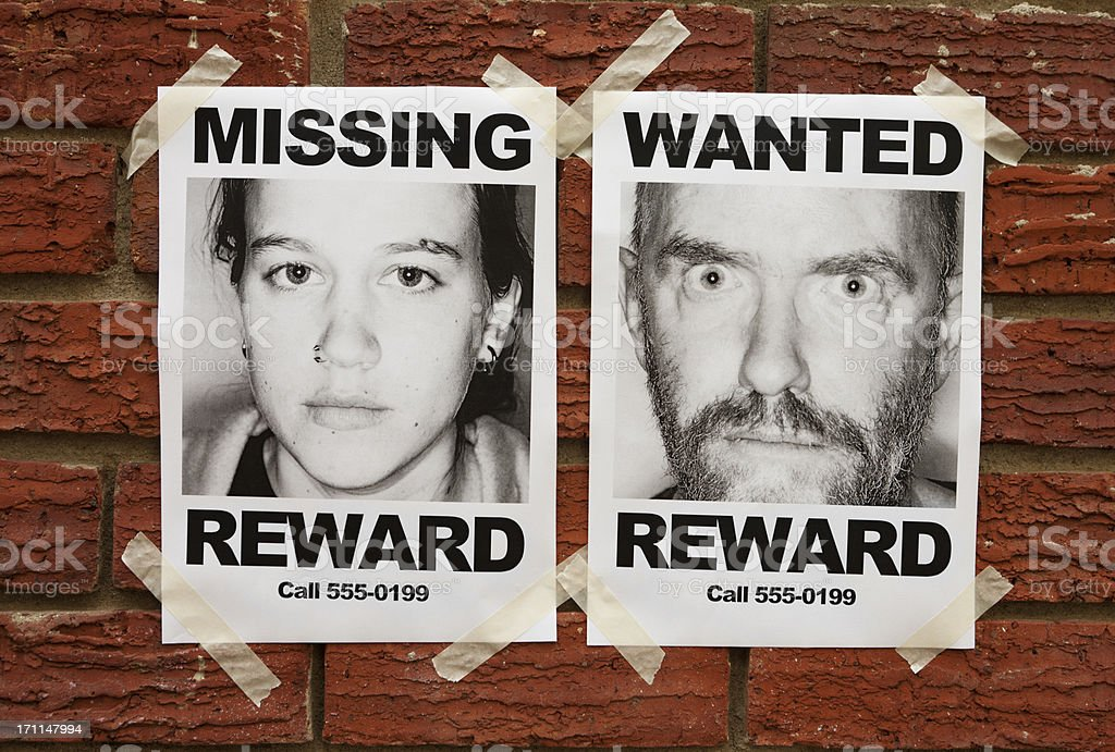 """""""Missing"""" and """"Wanted"""" posters taped to brick wall royalty-free stock photo"""