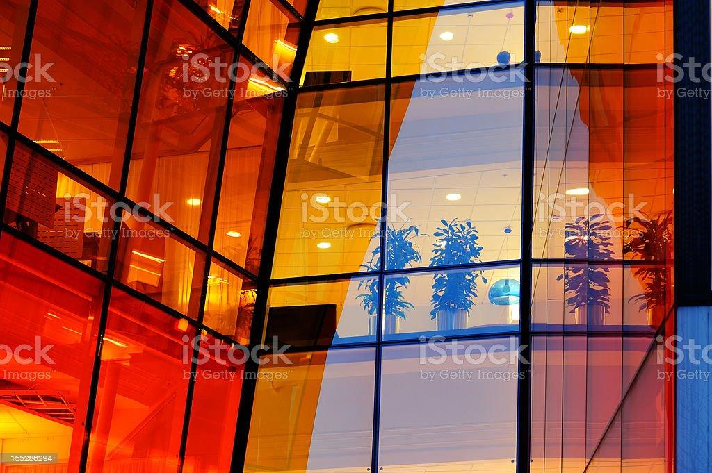 """Orange"" office windows by night. royalty-free stock photo"