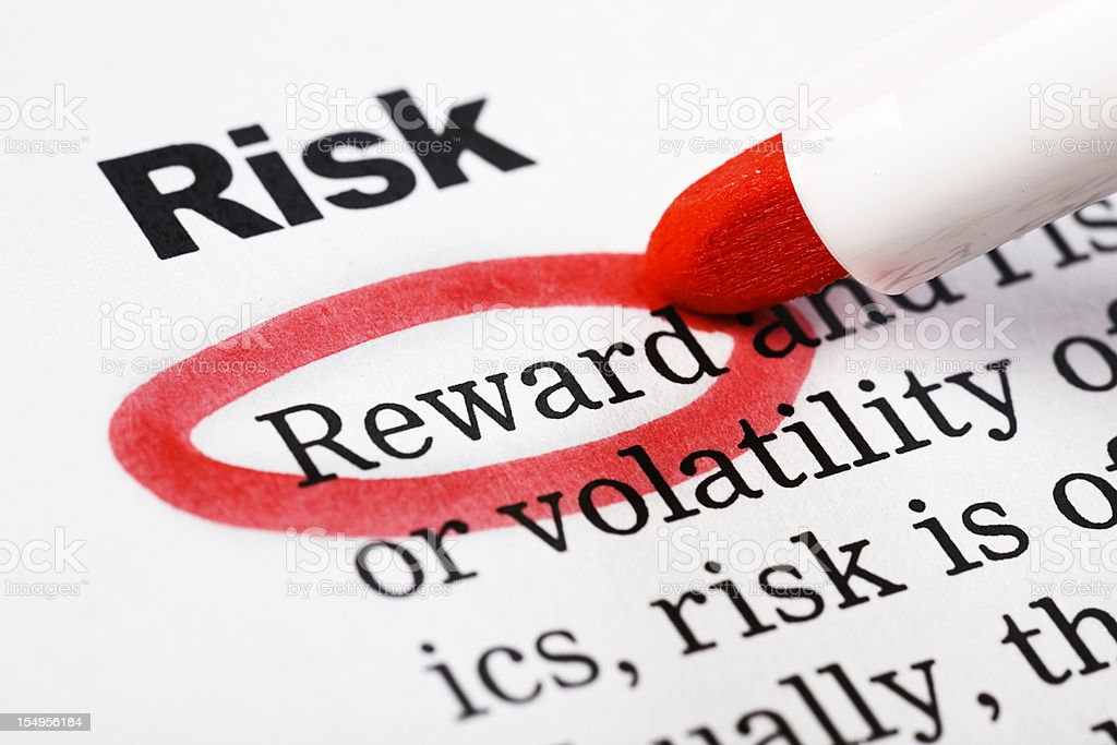 """Reward"" highlighted in red under heading ""Risk"" on printed document royalty-free stock photo"