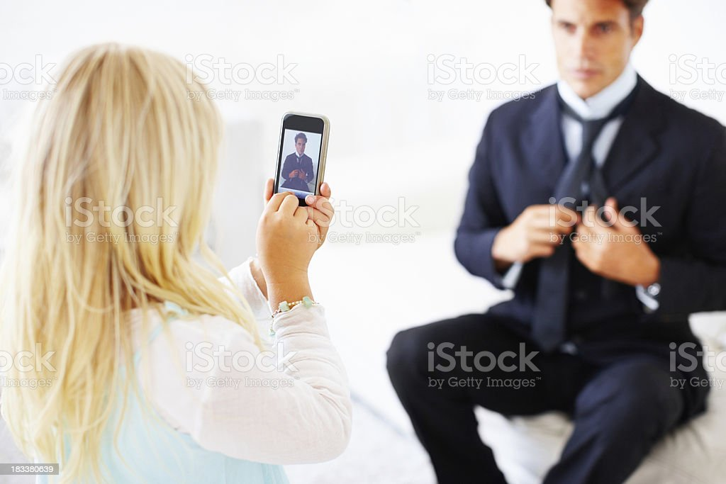 """""""Taking a picture of dad"""" royalty-free stock photo"""