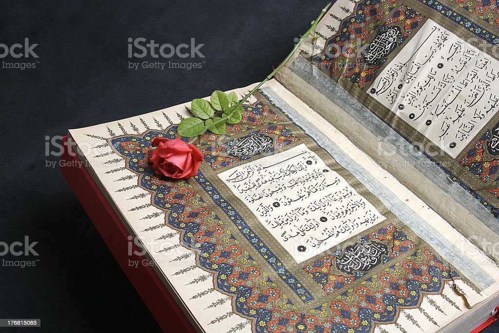 Quran and roses stock photo