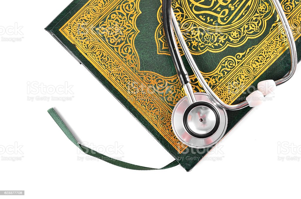 Quran with stethoscope. Concepts of medication and healthcare in islam stock photo