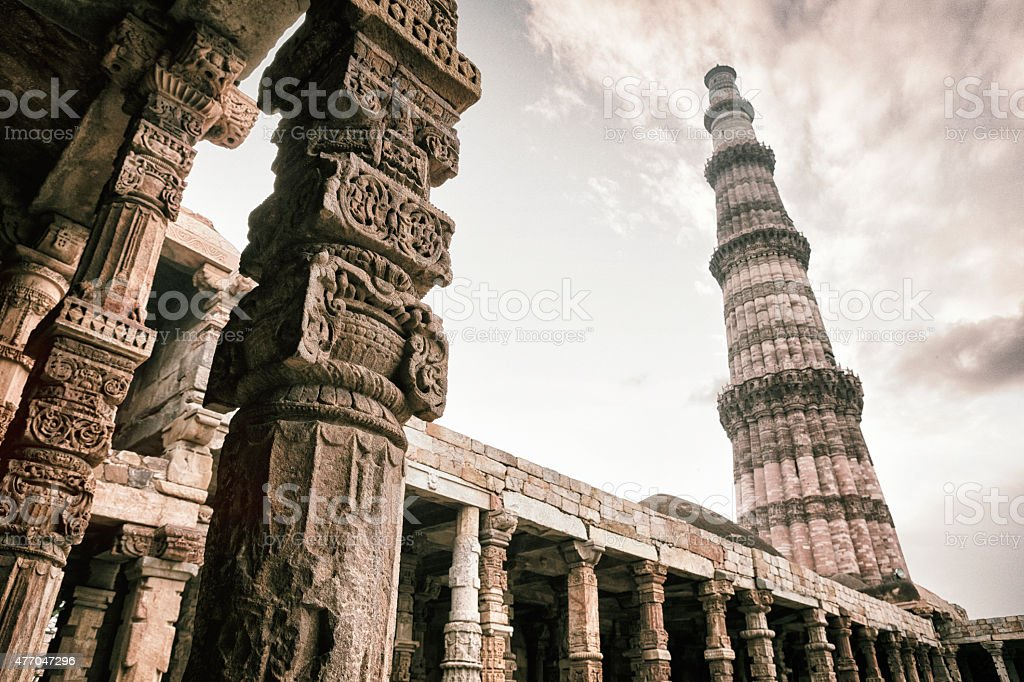 Qutb Minar and Quwwat ul-Islam Mosque Columns in Delhi, India stock photo