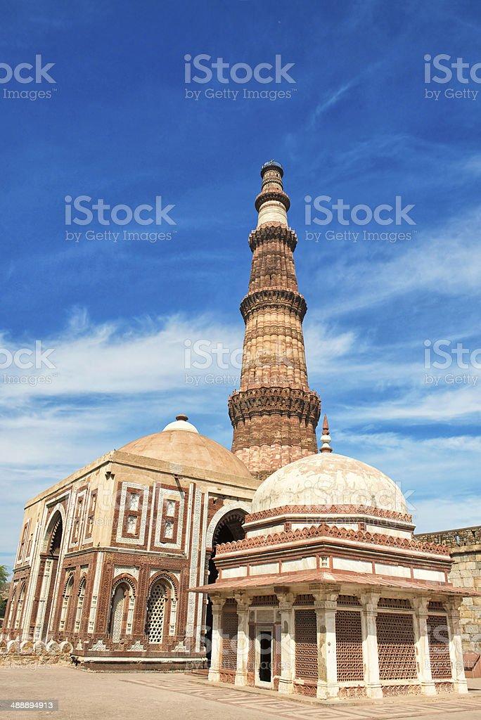 Qutb Minar with tomb of Imam Zamin royalty-free stock photo