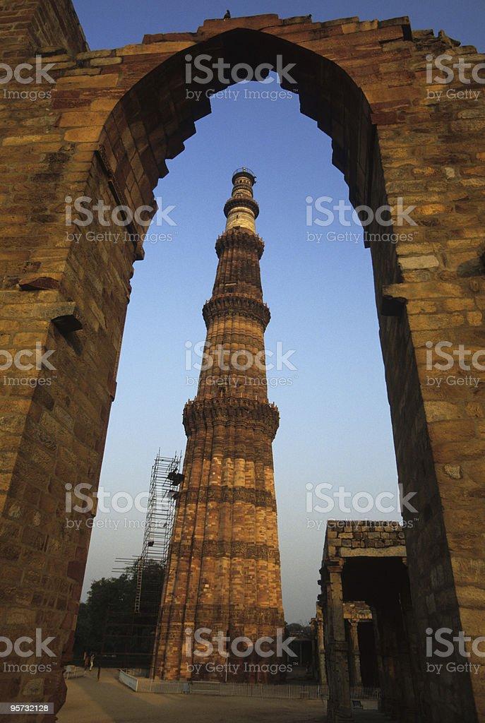 Qutub Minar framed in gate, Delhi, India royalty-free stock photo