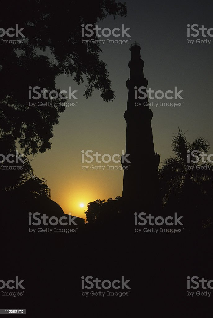 Qutub Minar silhouette, Delhi, India stock photo
