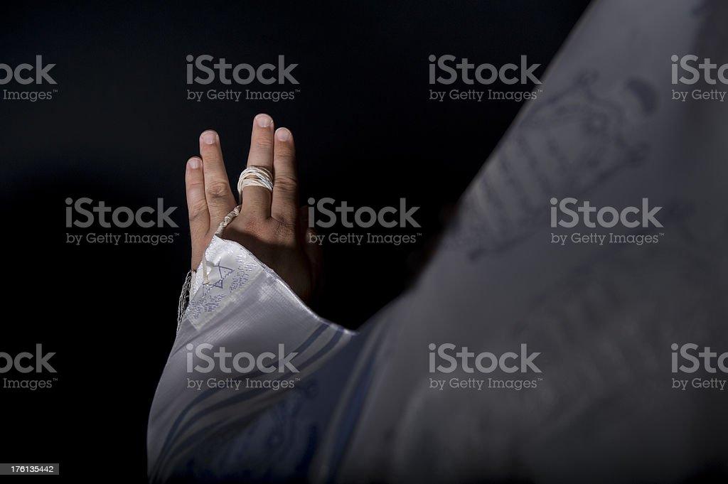 Rabbi Hand and Tzitzit on a Tallit stock photo