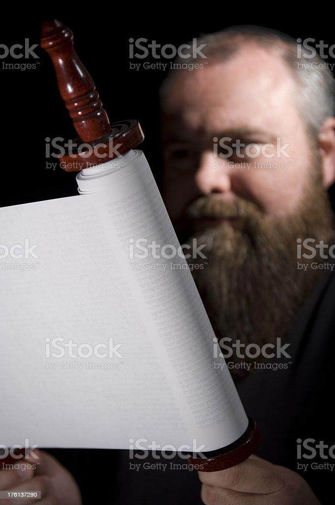 Rabbi Reading Torah Scroll stock photo