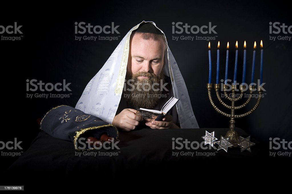 Rabbi Reads From the Siddur During Prayers stock photo