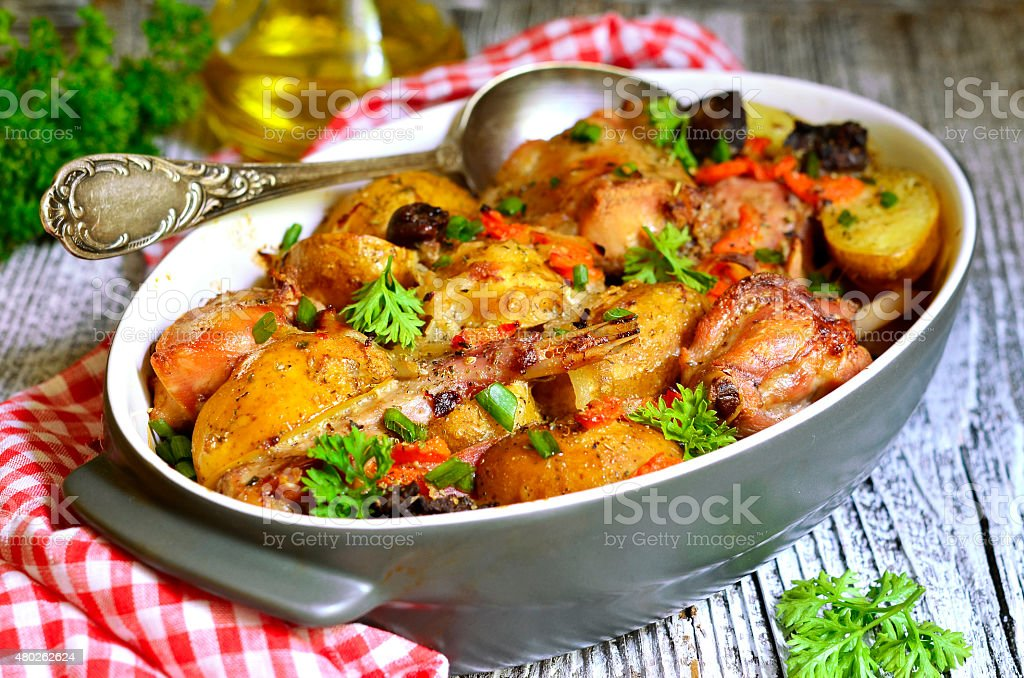 Rabbit baked with young potato in a cream. stock photo