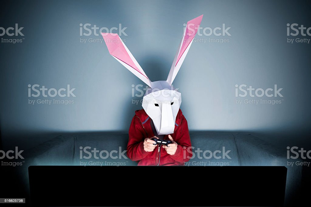 Rabbit gamer on the sofa stock photo