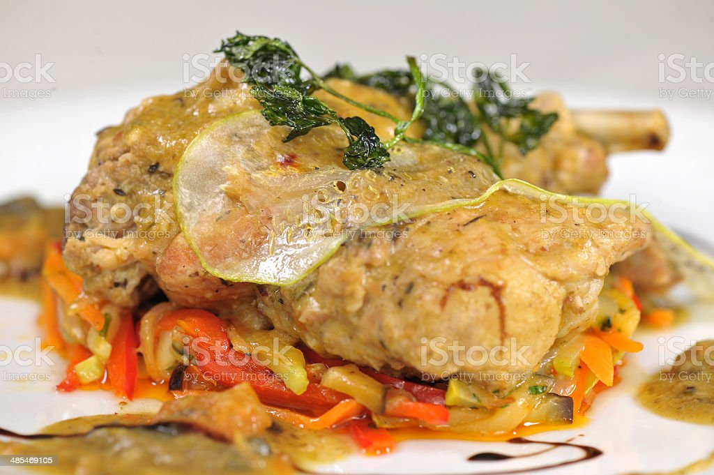 Rabbit stewed with vegetables stock photo