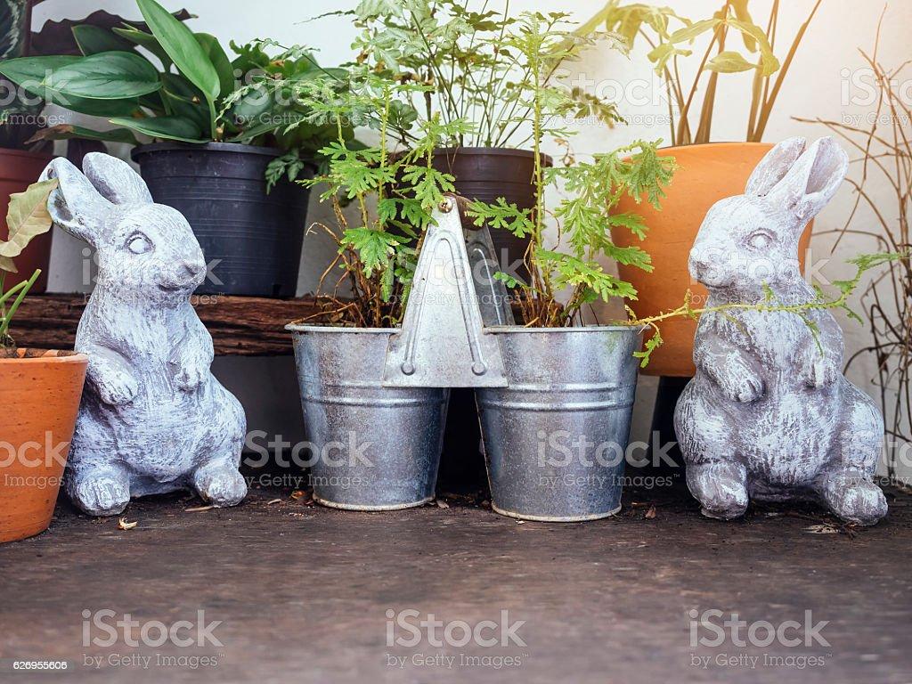 Rabbits Bunny Doll Plant pots Outdoor Garden decoration stock photo