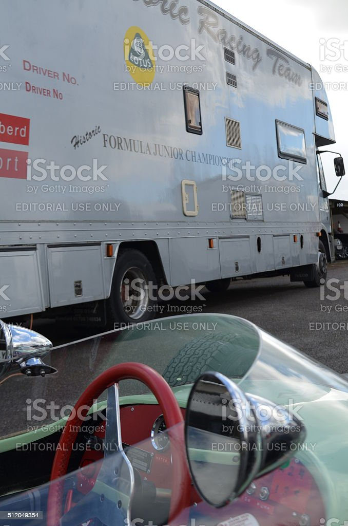 Race car and transporter at Goodwood motor circuit. stock photo